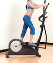 Woman training on exercise bicycle air stepper Stock Photos