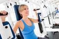 Woman training at the gym Royalty Free Stock Photos