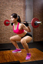 Woman with barbell Royalty Free Stock Photo