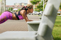Woman Training Pectorals Doing Pushups On Street Bench Royalty Free Stock Photo