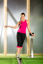 Woman training with slackline in a fitness club or gym Stock Image