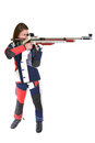 Woman training sport shooting with air rifle gun in studio Stock Photo