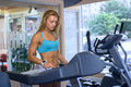 Woman trains cardio in gym Royalty Free Stock Photo