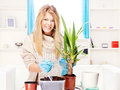 Woman transplant plant in a bigger pot Stock Photography