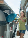 Woman with trash bags near garbage bin Royalty Free Stock Photo