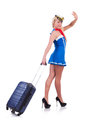 Woman travel attendant with suitcase on white Royalty Free Stock Photo