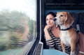 Woman travel with dog into the train wagon Royalty Free Stock Photo