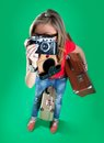 Woman traveler with a camera green background Stock Photo