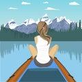 Woman traveler floating on boat on mountain lake