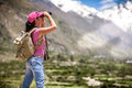 Woman traveler looks into the distance Stock Photography