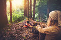 Woman traveler relaxing in forest and cooking food Royalty Free Stock Photo