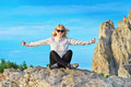 Woman traveler relaxing yoga meditation sitting on stones relaxing with rocky mountain peak ai petri and blue sky background Royalty Free Stock Images