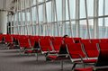 Woman traveler sleeps at hong kong airport february a female sleeping an otherwise empty bank of seats honk international s Stock Photo