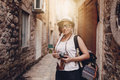 Woman traveler with vintage camera taking photo Royalty Free Stock Photo