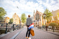 Woman traveling in Amsterdam city Royalty Free Stock Photo