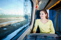 Woman traveling by train Stock Images