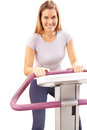 Woman on treadmill in fitness Royalty Free Stock Photos