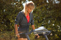 Woman on the treadmill running outdoors strange situation ideal for commercial Stock Photography