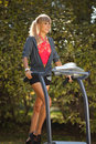 Woman on the treadmill running outdoors strange situation ideal for commercial Stock Images