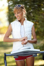 Woman on the treadmill running outdoors strange situation ideal for commercial Stock Image
