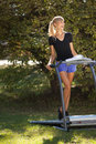 Woman on the treadmill running outdoors strange situation ideal for commercial selective focus Stock Image