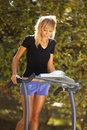 Woman on the treadmill walking outdoors strange situation ideal for commercial Stock Photos