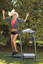Woman on the treadmill walking outdoors strange situation ideal for commercial Royalty Free Stock Images