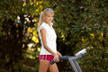 Woman on the treadmill walking outdoors strange situation ideal for commercial Stock Photo