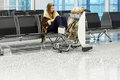 Woman and trolley with bag waiting at an airport Stock Photos