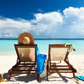 Woman on a tropical beach in chaise lounge at maldives Royalty Free Stock Image