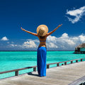 Woman tropical beach jetty maldives Stock Image