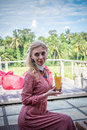 Woman with tropical mango juice outdoors, cafe. Bali island. Royalty Free Stock Photo