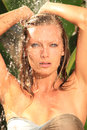 Woman in tropical shower palms around Royalty Free Stock Photography