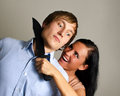 Woman is trying to kill man Royalty Free Stock Photo