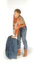 Woman trying to open her suitcase isolated Royalty Free Stock Photo