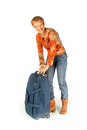 Woman trying to open her suitcase on white Stock Photos