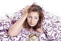 Woman trying to sleep the closed the blanket insomnia topic Stock Images