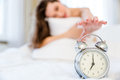 Woman trying to turn off the alarm clock Royalty Free Stock Photo