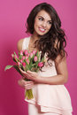 Woman with tulips beautiful young posing pink Stock Images