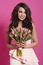 Woman with tulips smiling elegant pink Royalty Free Stock Photography
