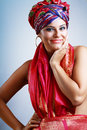 Woman in turban a photo of beautiful girl a head dress from the coloured fabric and red ethnic dress Royalty Free Stock Photos
