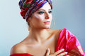 Woman in turban a photo of fashionable beautiful young a head dress from the coloured fabric and red ethnic dress Stock Photography