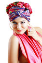 Woman in turban a photo of fashionable beautiful young a head dress from the coloured fabric and red ethnic dress isolated over Royalty Free Stock Photo