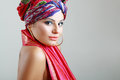 Woman in turban young beautiful slim on her head happy smiling and put hand on her head Stock Photos