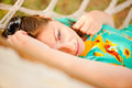 Woman in a turquoise dress resting in a hammock Royalty Free Stock Photos