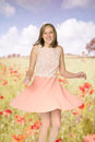 Woman twirling her dress in summer poppy field Royalty Free Stock Photos