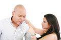 Woman twisting boyfriends ear Royalty Free Stock Photos