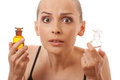 Woman with two bottles of medicine or perfume Royalty Free Stock Photo