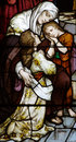 Woman with two children in stained glass