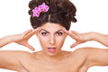 Woman with two flowers orchid in hair Stock Photos